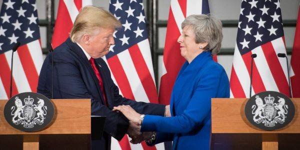 Theresa May accuses populist politicians like Trump of trading on the 'politics of division'