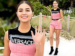 Olivia Culpo shows off her legs in romper as she walks on beach in stiletto boots at charity event