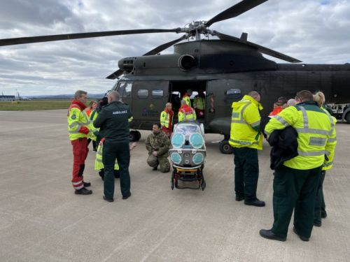Helicopter crews in Moray practise loading isolation stretcher for virus patients into aircraft