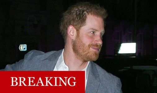Prince Harry looks relaxed as he's pictured for first time since royal deal was reached