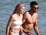 Tennis ace Eugenie Bouchard shows off her incredible physique in a sporty white bikini