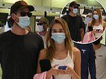 Liam Hemsworth and Gabriella Brooks look casual cool as they jet into Sydney