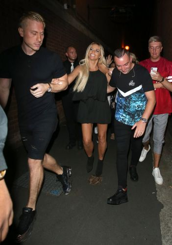 Kris Boyson doesn't look impressed with Katie Price as he helps her into boozy midnight performance