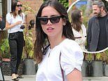 Ana de Armas is pretty in a white top while dining with a friend in Venice Beach