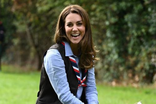 Kate Middleton wears jeans and a gilet during visit to London Scouts Group