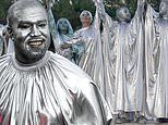 Kanye West dons silver body paint and matching bizarre baggy outfit at his new opera Mary in Miami