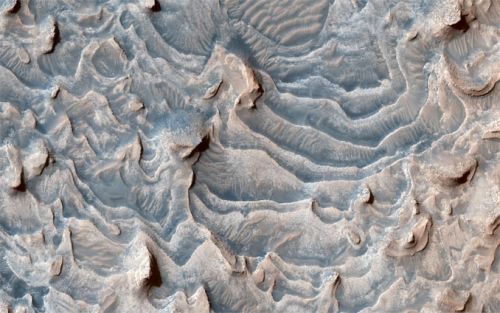 Erosion in a martian crater carves buttes and stair-like layers
