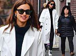 Irina Shayk appears to be in a good mood as she shops with her mother Olga