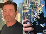 Homesick Hugh Jackman builds  jigsaw of Sydney Opera House - before destroying it in frustration