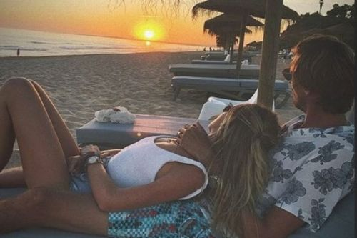 Abbey Clancy and Peter Crouch pose for romantic snap during Portugal break