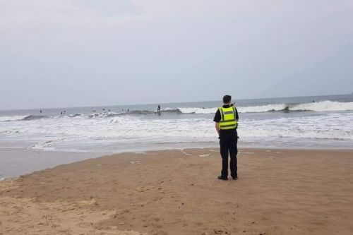 Surfers flout coronavirus lockdown to catch waves in the sunshine