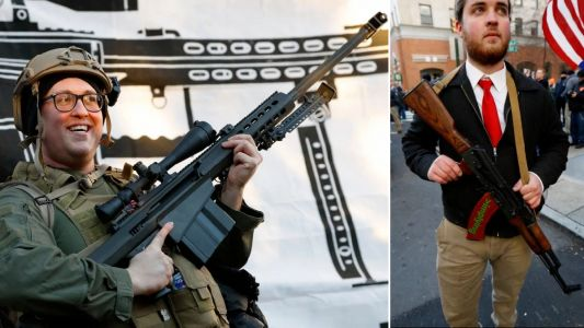 Protesters toting huge rifles attend anti-gun law rally amid fears of deadly violence