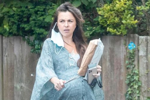 EastEnders star Louisa Lytton shows off heavily pregnant bump during stroll