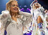 Rita Ora sizzles in daring white ensemble and silver thigh-high boots onstage in Birmingham