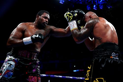 Dillian Whyte overcomes a knockdown to win a back-and-forth blockbuster, setting up a potential Deontay Wilder payday next year
