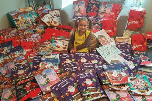 Eight-year-old girl donates 215 advent calendars to food bank
