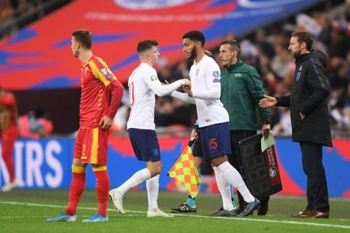 Raheem Sterling claps Joe Gomez's introduction vs Montenegro as he is booed by England fans