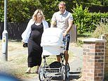 Danielle Armstrong enjoys a walk with newborn daughter Orla Mae and fiancé Tom Edney