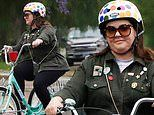 Melissa McCarthy takes tricycle out for a cruise around her neighborhood