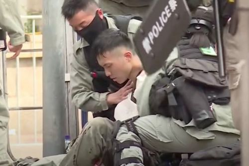 Horror moment Hong Kong police officer stabbed during clashes with protesters