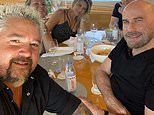 John Travolta takes a trip to Flavortown to hang out with Guy Fieri at a restaurant