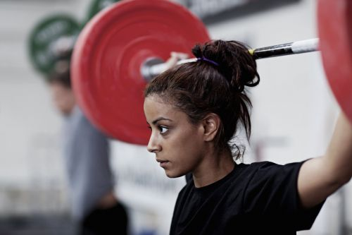 I'm a long-time runner who recently took up weightlifting but my body hasn't changed. Is cardio a hindrance to strength-training?