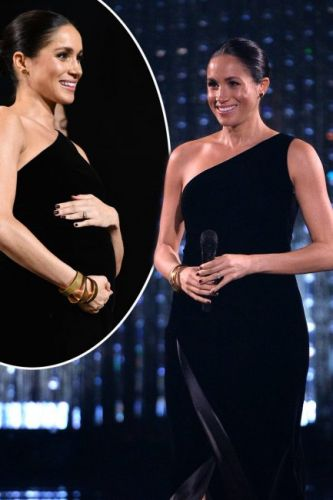 Meghan Markle cradles blossoming baby bump as pregnant royal makes surprise appearance at The British Fashion Awards