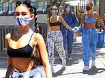 Madison Beer flaunts her midriff in black sports bra with sweats as she grabs lunch in Beverly Hills