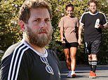 Jonah Hill and fiancee Gianna Santos are all smiles as they step out for a long walk in Santa Monica