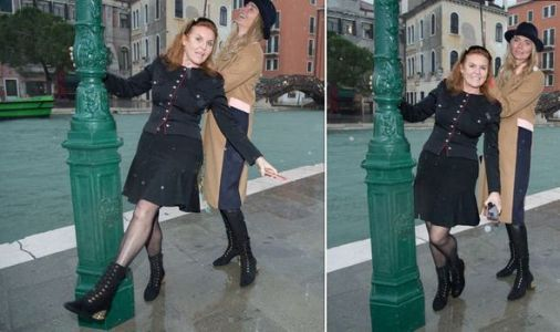 Sarah Ferguson poses swinging around lamp post as she visits Venice flooding victims