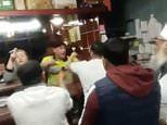 Shocking moment 'chilli powder' is thrown in a man's face during a violent brawl