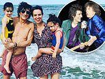TALK OF THE TOWN: Rolling Stones wildman Ronnie Wood shows off trim physique