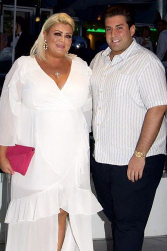 Gemma Collins flaunts weight loss in jaw-dropping white gown as she cuddles up to boyfriend James Argent in Spain