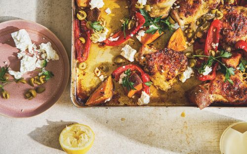 Roast chicken thighs with red peppers, sweet potatoes, green olives and feta recipe