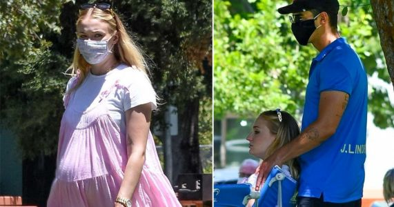 Sophie Turner is pretty in pink as she and bump get shoulder rub from Joe Jonas during LA picnic