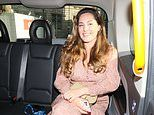 Kelly Brook channels boho chic in a dusky pink dress as she heads home in a taxi