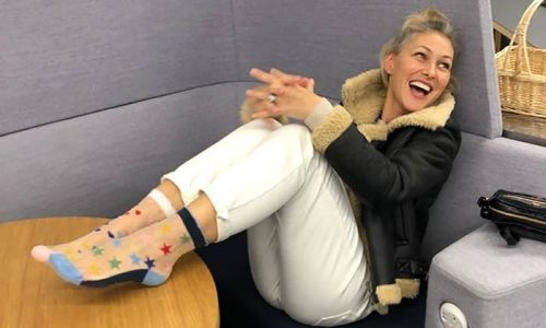 Emma Willis shows off her stunning open plan kitchen and living room - and her lush purple sofa