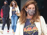 Cindy Crawford goes casual in a white coat and a T-shirt with her son Presley Gerber to run errands