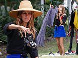 Anti-vaxxer actress Isabel Lucas is pictured selling her own clothes at a pop-up store in Byron Bay