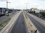 Africa's biggest city lies empty: Deserted streets in Lagos after Nigeria locks down its capital
