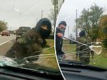 Masked assailants attack Ontario cops by smashing their cruiser's windshield during land protest