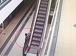 Boy, four, seriously injured after clinging to escalator handrail and falling 20ft at Russian mall