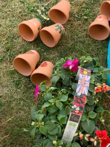 Three north-east youngsters paint flowerpots to raise funds for NHS