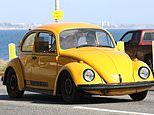 Ewan McGregor takes daughters out for a spin in his yellow Volkswagen beetle amid COVID-19 lockdown