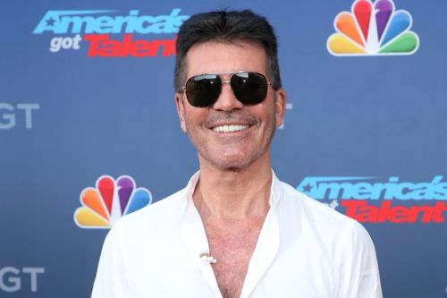 Simon Cowell 'has taken first steps and on the mend' after breaking his back