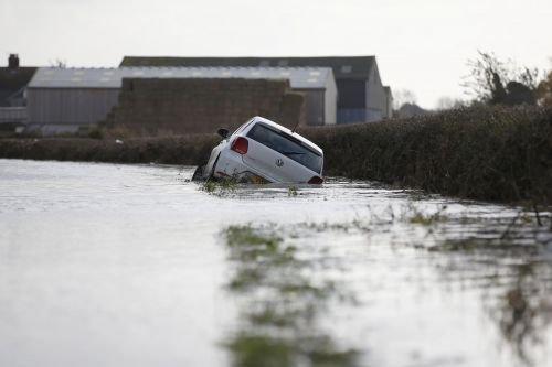 Flooding could drag on until Tuesday as 80 warnings in place across England