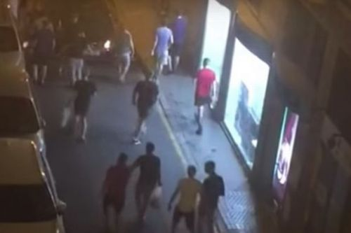 'Drunken' England fans clash with riot police in Seville before Spain game