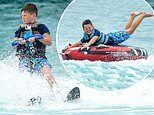 Wayne Rooney's son Kai, 9, enjoys a day of water sports with younger brotherKlay, 6, in Barbados