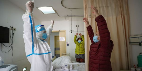 A city in Hubei, China, is giving residents $1,400 if they report their coronavirus symptoms to doctors and then test positive