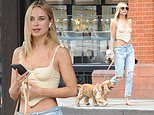 Kimberley Garner flaunts cleavage in a racy bustier and jeans as she steps out in Chelsea